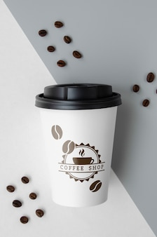 Paper coffee cup on bicolored background