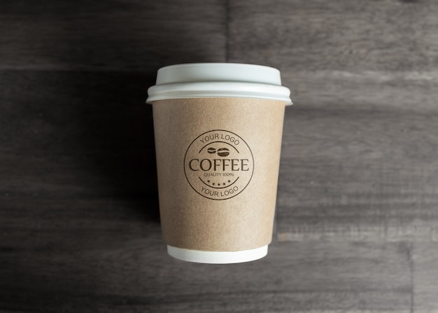 Paper coffee cup mockup on wooden table