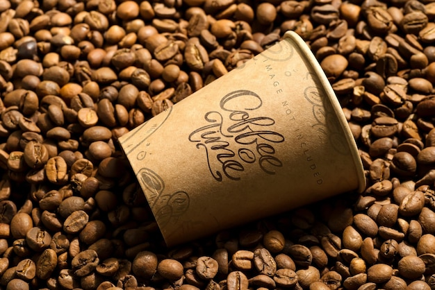 Paper cup mockup on a coffee beans. takeaway coffee concept