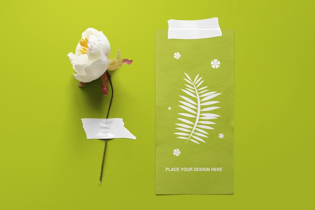 Paper and flower taped to the board mockup