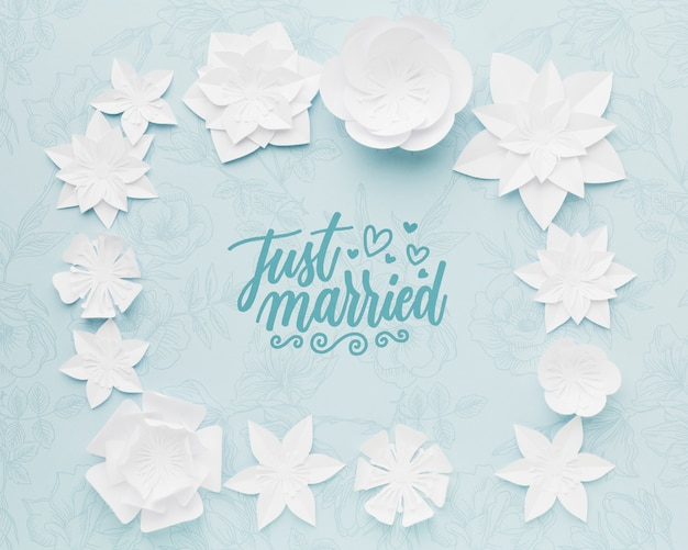 Paper flowers on blue wedding background mock-up