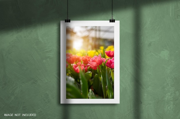 Paper frame photo mockup on concrete wall background