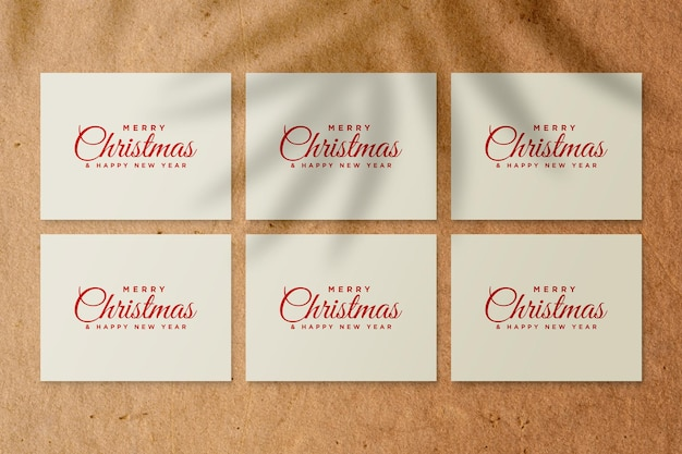 Paper greeting card mockup with christmas elements with palm leaves shadow
