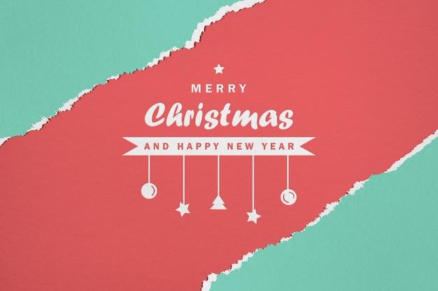 紙のメリークリスマスと新年あけましておめでとうございますのモックアップ