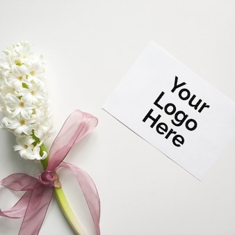 Paper mockup for logo with flower