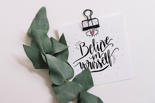 Paper mockup with clip and leaves for quote