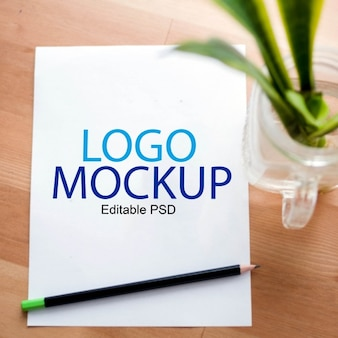 Paper mockup with plant for logo