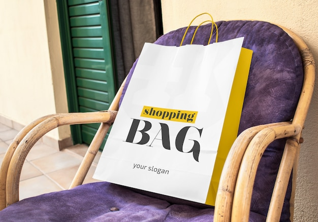 Paper shopping bag on the chair mockup