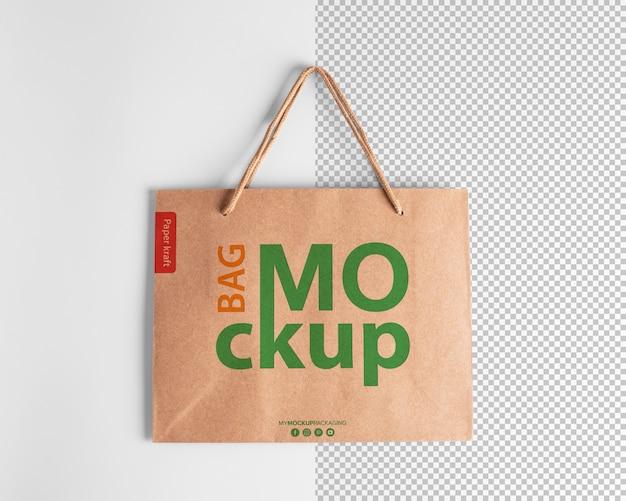 상위 뷰에서 로고가있는 종이 쇼핑백 모형 포장 템플릿