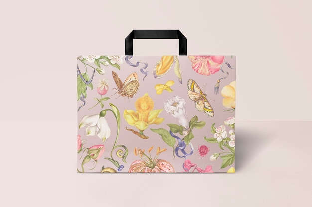 Paper shopping bag mockup psd in pink floral pattern vintage style