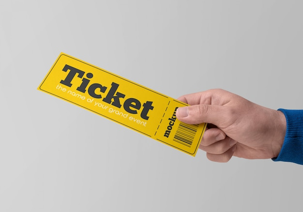 Paper ticket in hand mockup