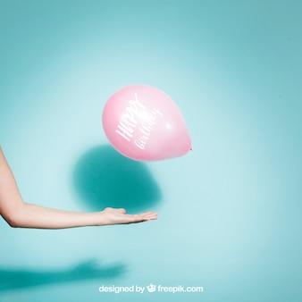 Концепция партии с рукой и воздушным шаром