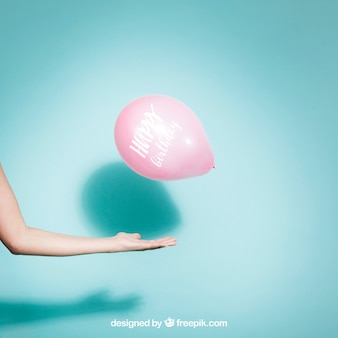 Party concept with arm and balloon