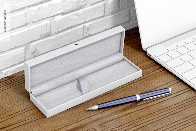 Penna in confezione regalo con mockup di laptop