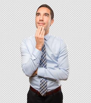 Pensive young businessman  posing