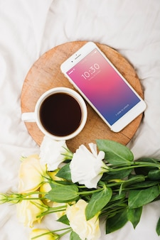 Peony flower mockup with coffee and smartphone