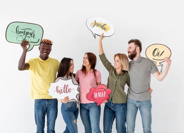 People holding chat bubbles with different language words