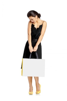 People, sale, black friday and luxury concept - woman shopping bags.