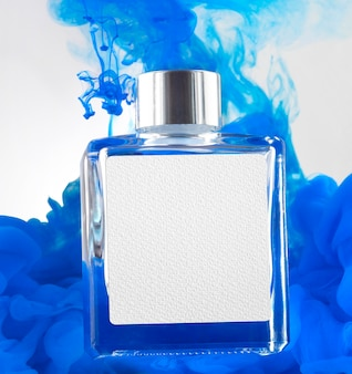 Perfume bottle and blue smoke mockup