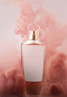 Perfume bottle and pink smoke