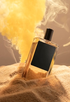 Perfume bottle in sand