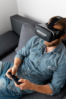 Person having fun at home with vr glasses mockup