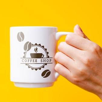 Person holding mug mock-up