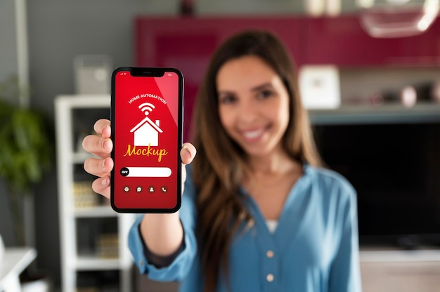Person holding a smartphone with a home automation app