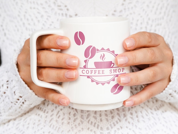 Person holding white coffee mug mock-up