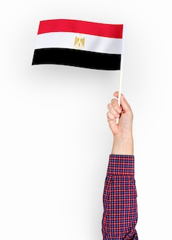 Person waving the flag of arab republic of egypt