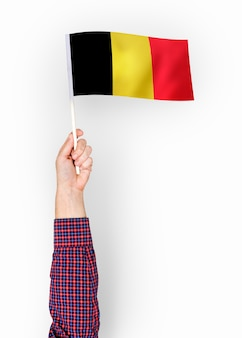 Person waving the flag of kingdom of belgium