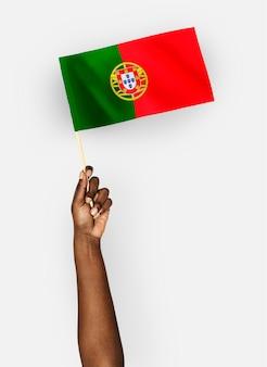 Person waving the flag of portuguese republic
