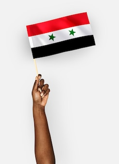 Person waving the flag of syria