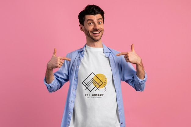Person with excited expression wearing tshirt mockup