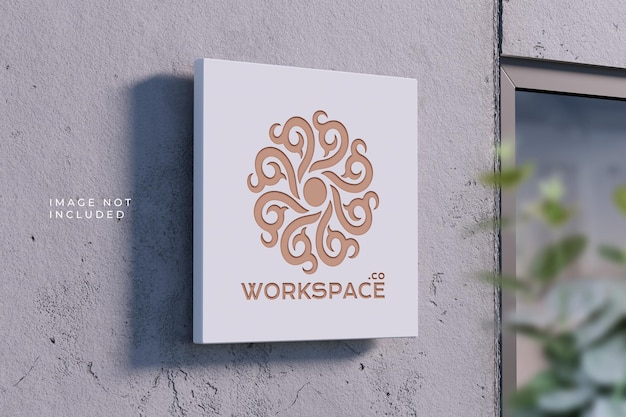 Perspective logo plaque on concrete wall - mockup
