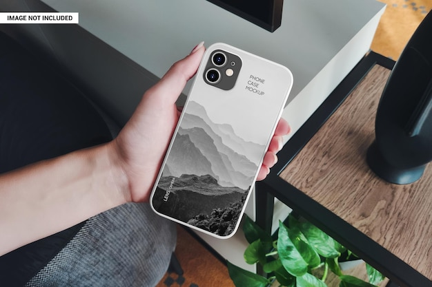 Phone case in the hand of a girl mockup Premium Psd