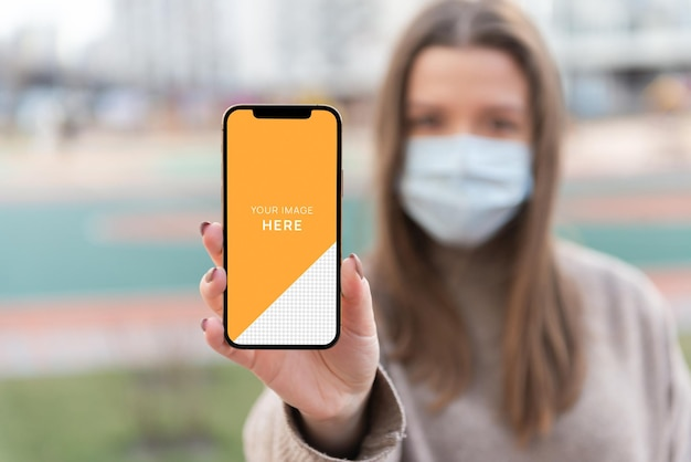 Phone help in hand person with facemask mockup