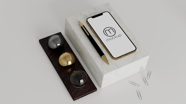 Phone on marble box mockup with pen and balls gold