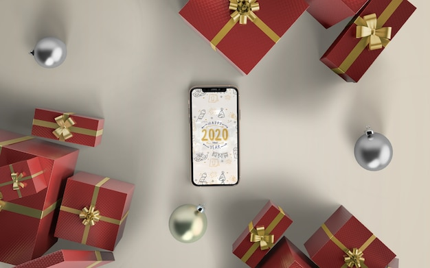 Phone mock-up with christmas gifts