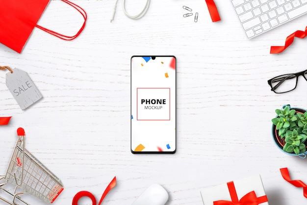 Phone mockup on desk with shopping items