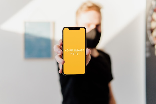 Phone mockup held in hand