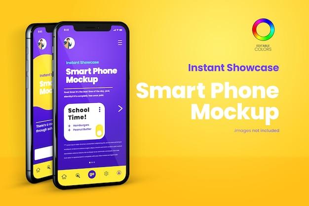 明るい黄色の部屋にある2台のスマートフォンの電話モックアップ
