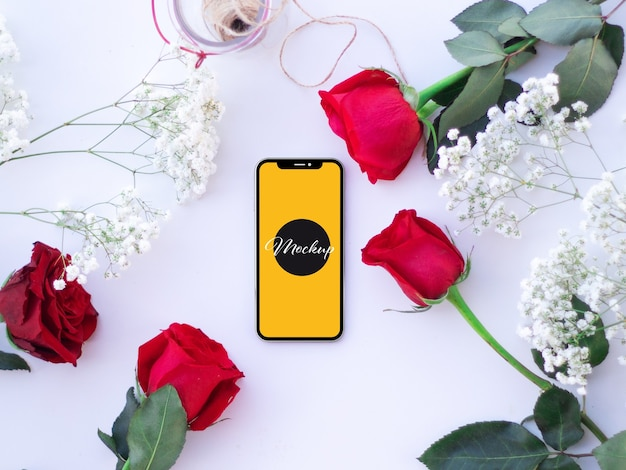Phone mockup with roses on a desk