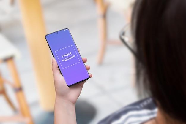 Phone mockup in woman hand.