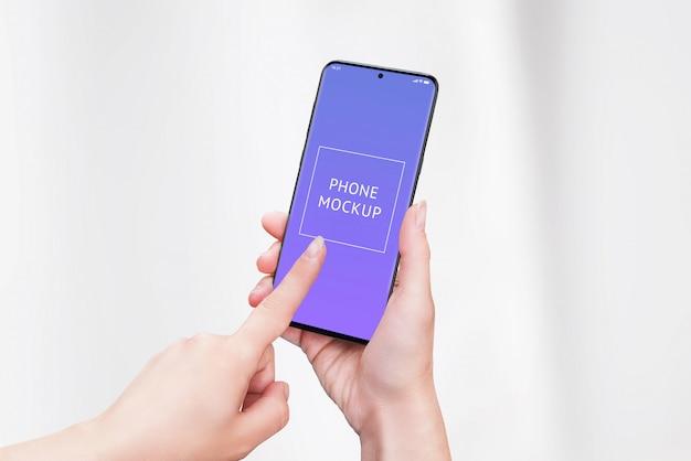 Phone mockup in woman hands.