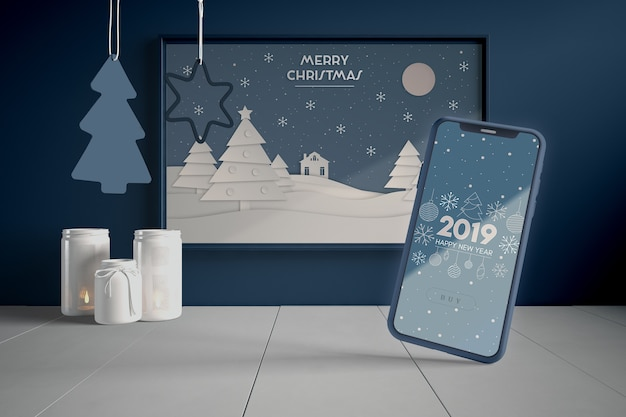 Phone and painting with christmas theme