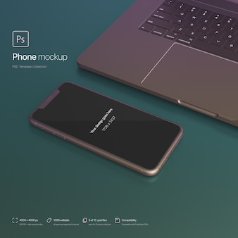 Phone setting next to a laptop at an abstract scene mockup