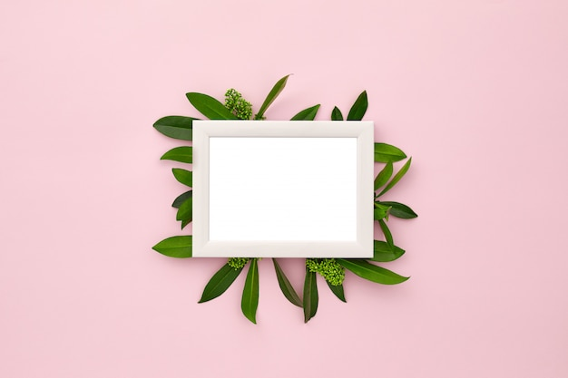 Photo frame decorated with green leaves