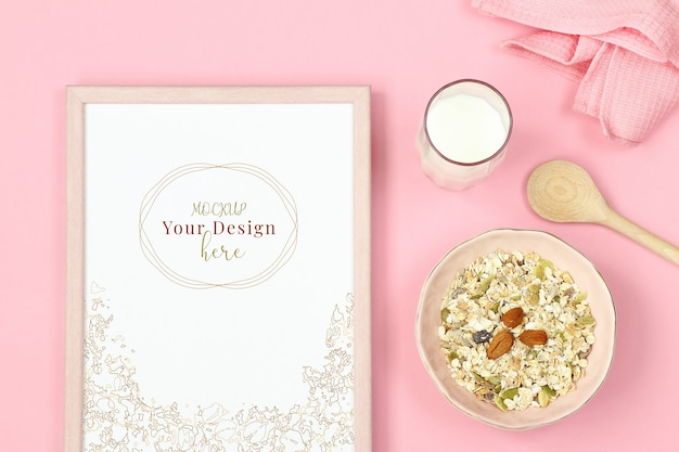 Photo frame mockup on pink background with muesli and glass of milk