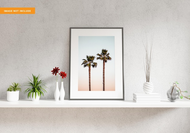 Photo frame mockup on white shelve with plants and decorations 3d rendering
